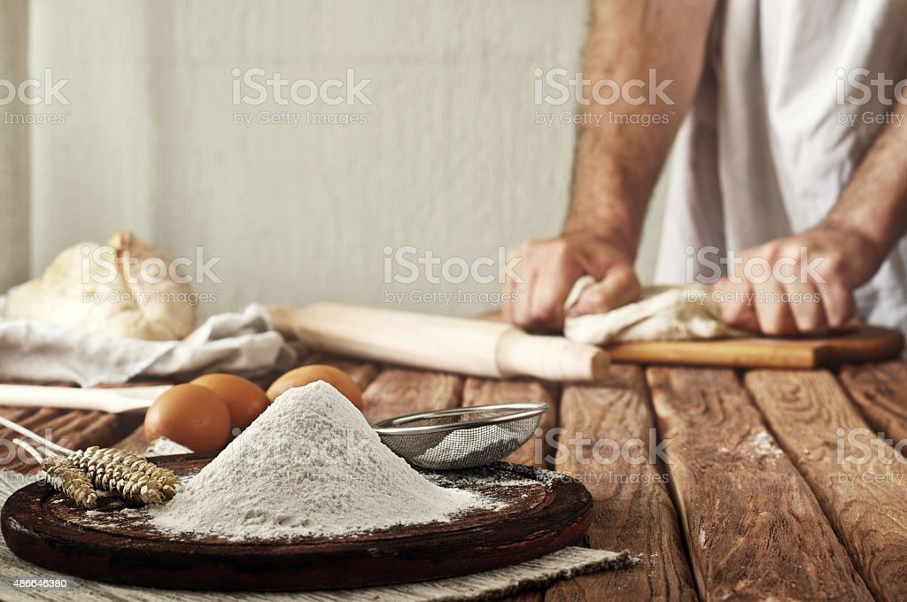 handful of flour on a rustic kitchen stock photo