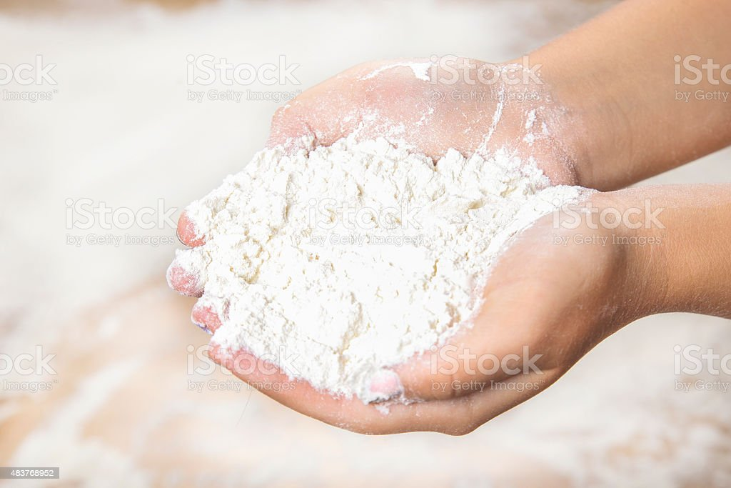 Handful of flour stock photo