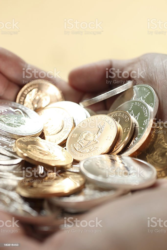 Handful of Gold and Silver Coins royalty-free stock photo