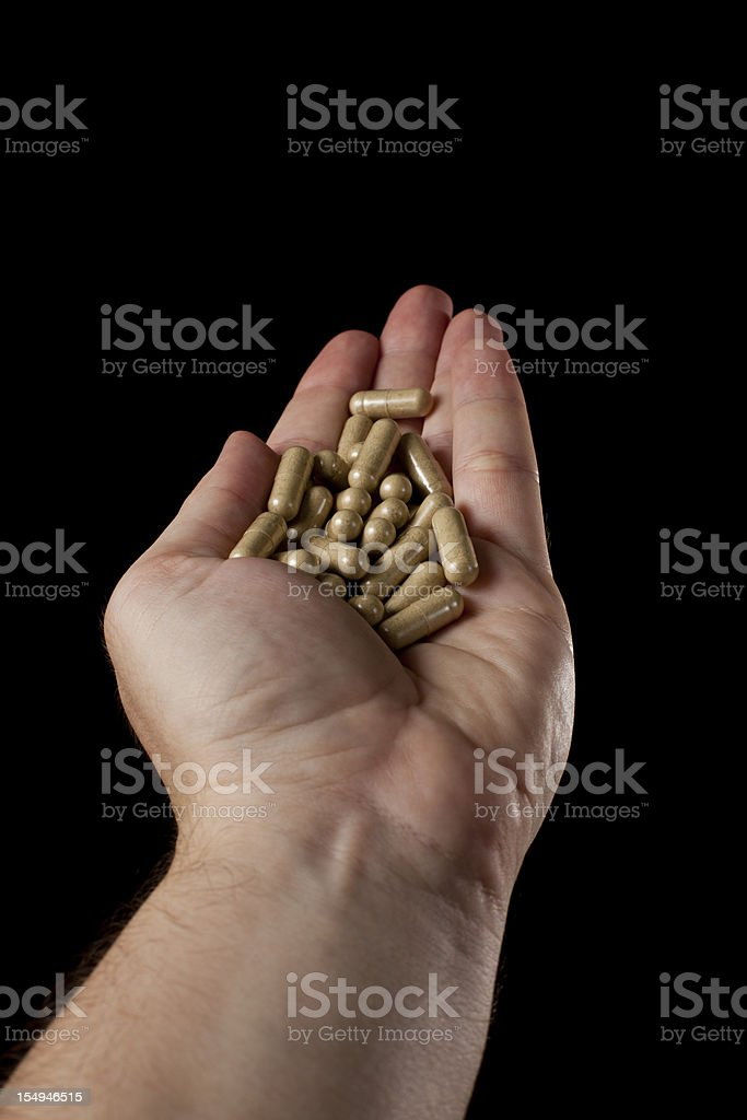 Handful of Herbal Capsules stock photo