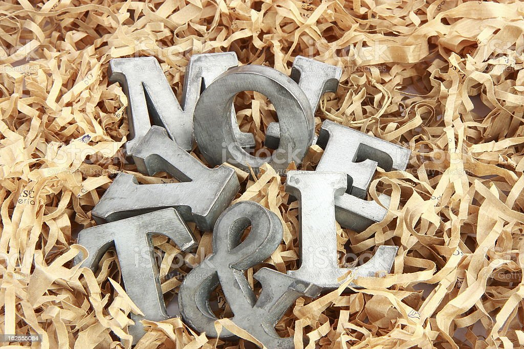 Handful of letters in shaving royalty-free stock photo