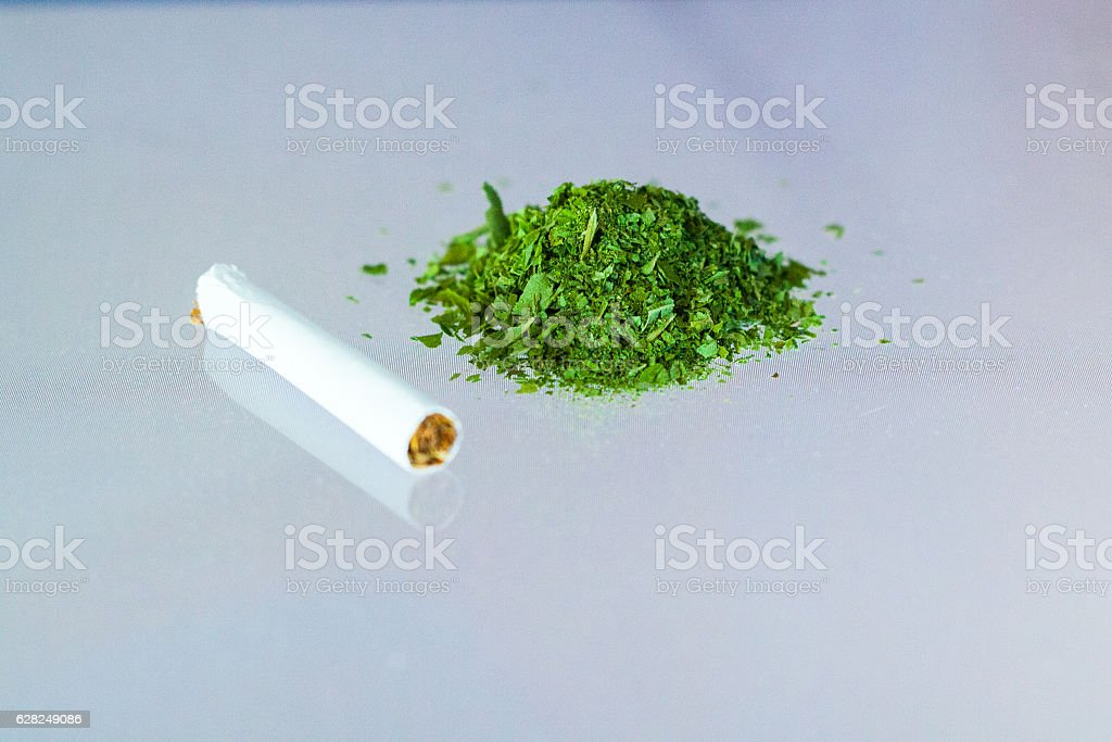 handful of medical cannabis marijuana stock photo