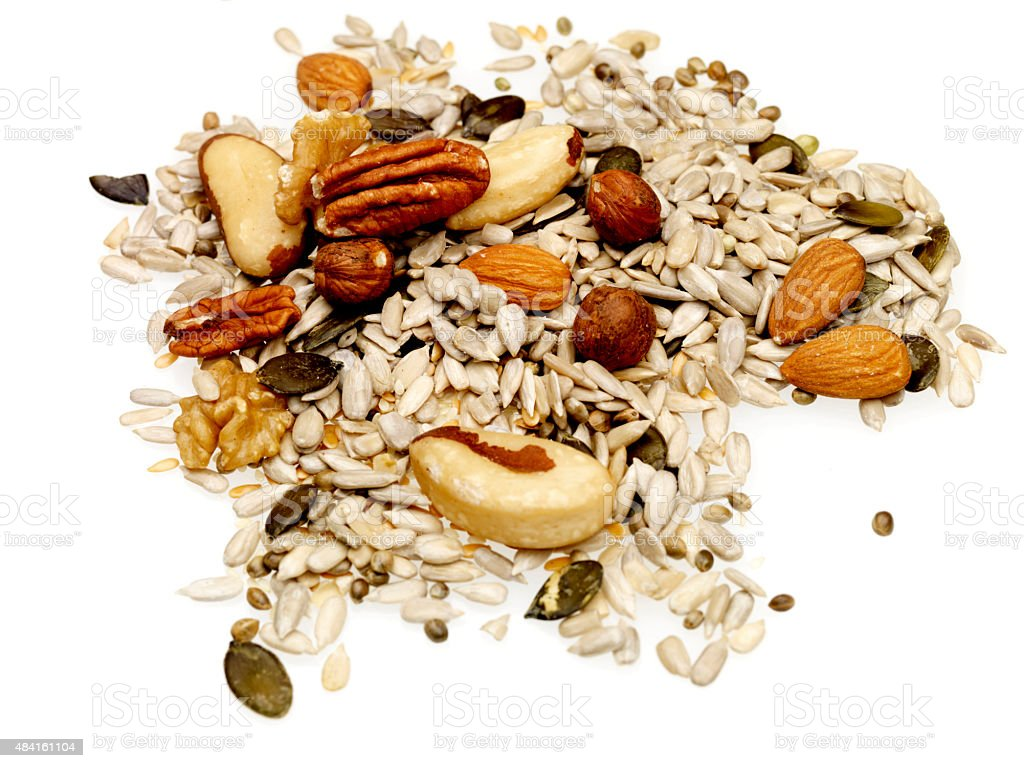 Handful of Mixed Dried Nuts and Seeds stock photo