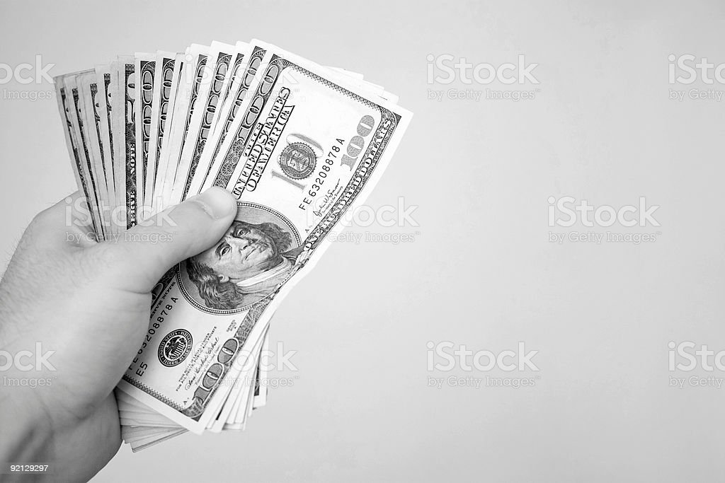 Handful of Money stock photo