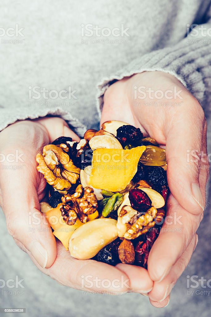 Handful of nuts and dried fruit mango, cranberry, goji stock photo
