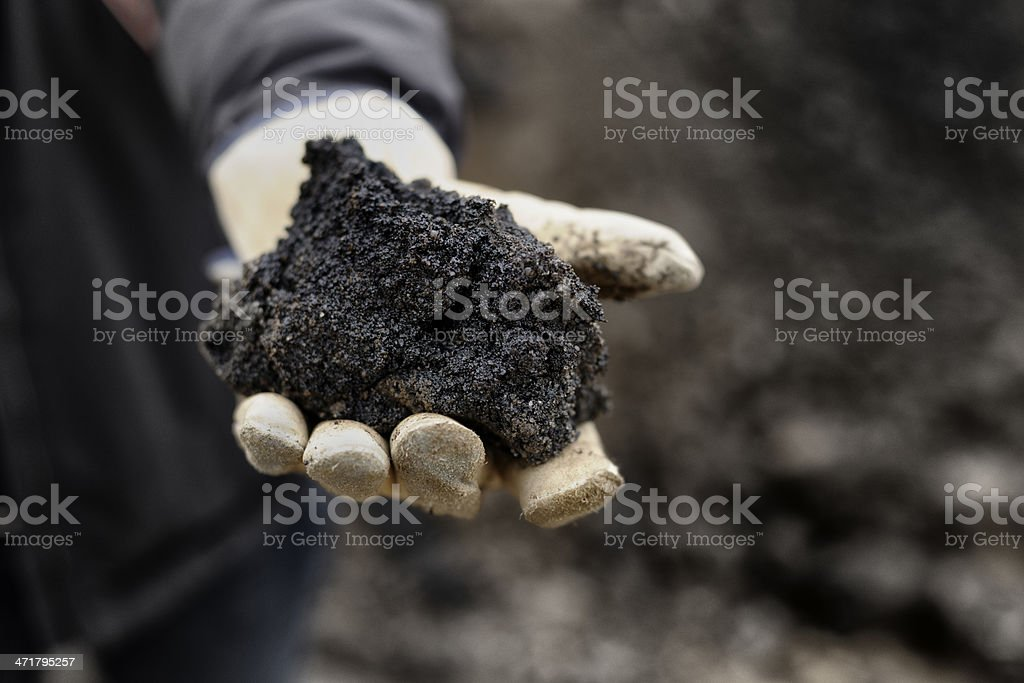 Handful of Oil Sand stock photo