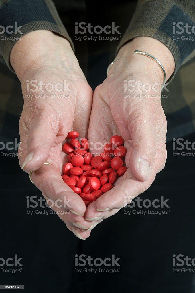 Handful of Pills stock photo