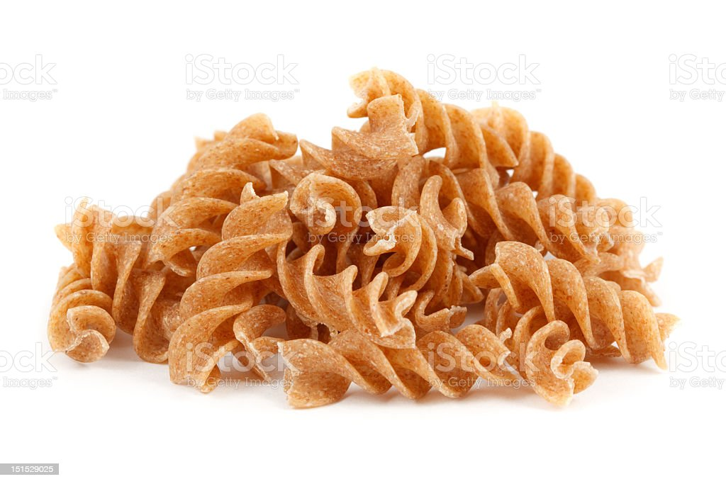 Handful of raw whole meal pasta stock photo