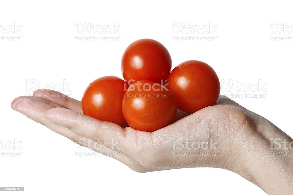 handful of red cherry tomatos stock photo