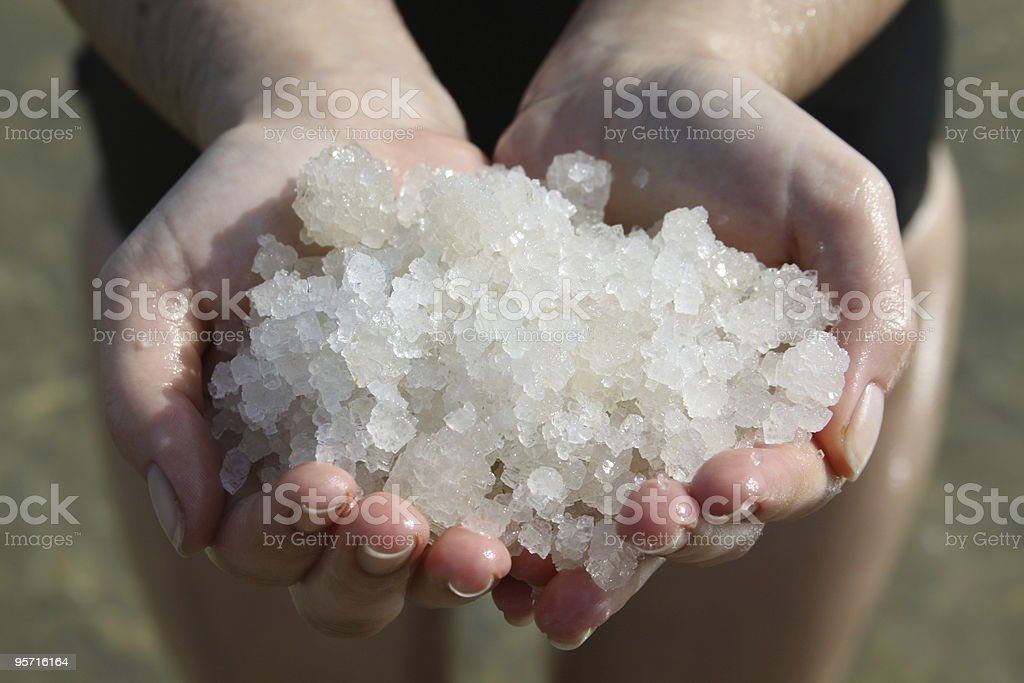 Handful of salt from the Dead Sea stock photo