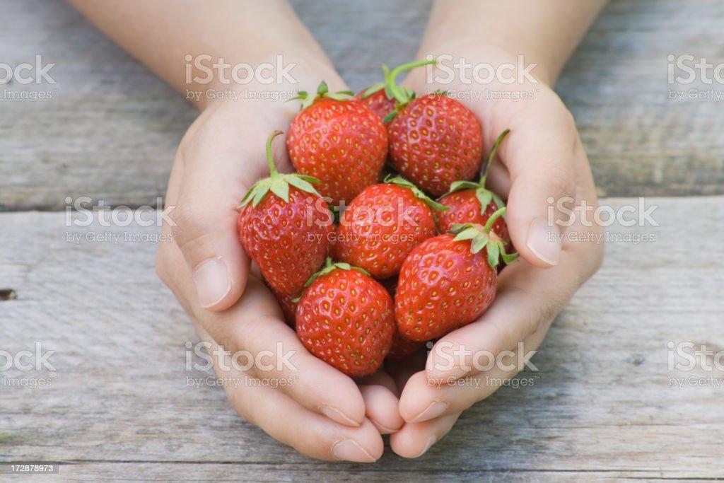 Handful of strawberries stock photo