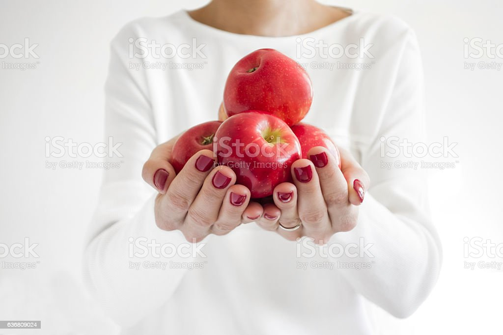 handfull of apples stock photo