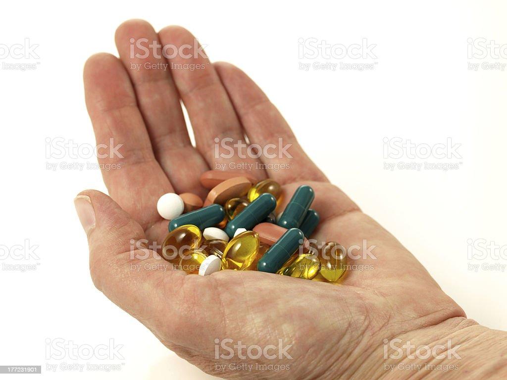 Handfull of pills, isolated stock photo