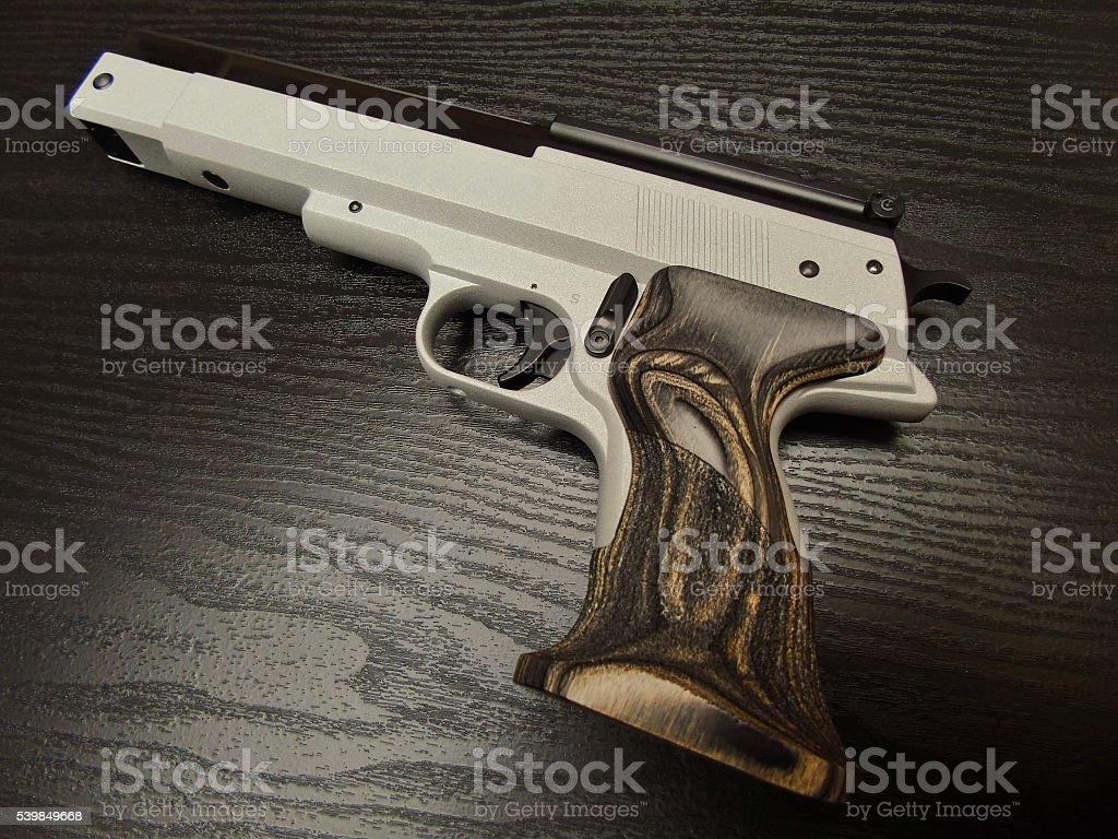 Handgun Airgun medium shot wooden grip stock photo