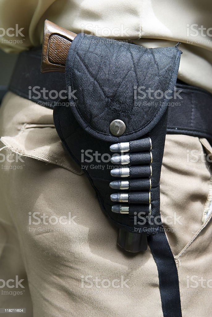 Handgun and bullets holdstered at waist royalty-free stock photo