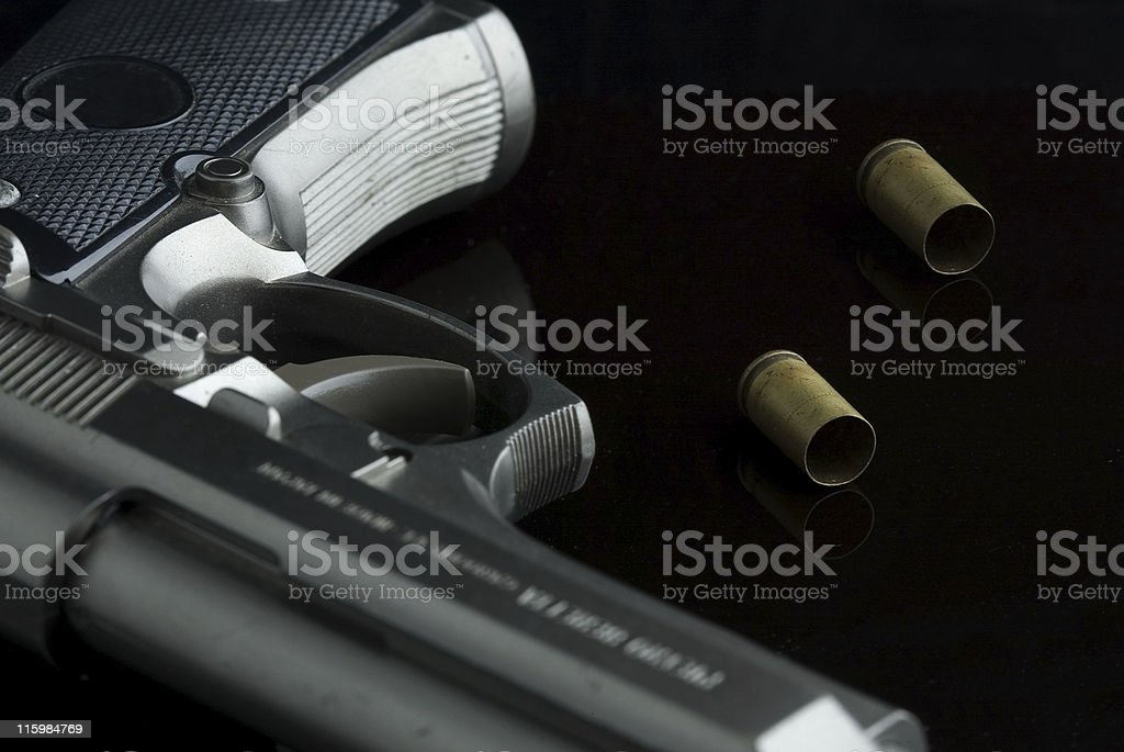 Handgun and empty Shell casings stock photo