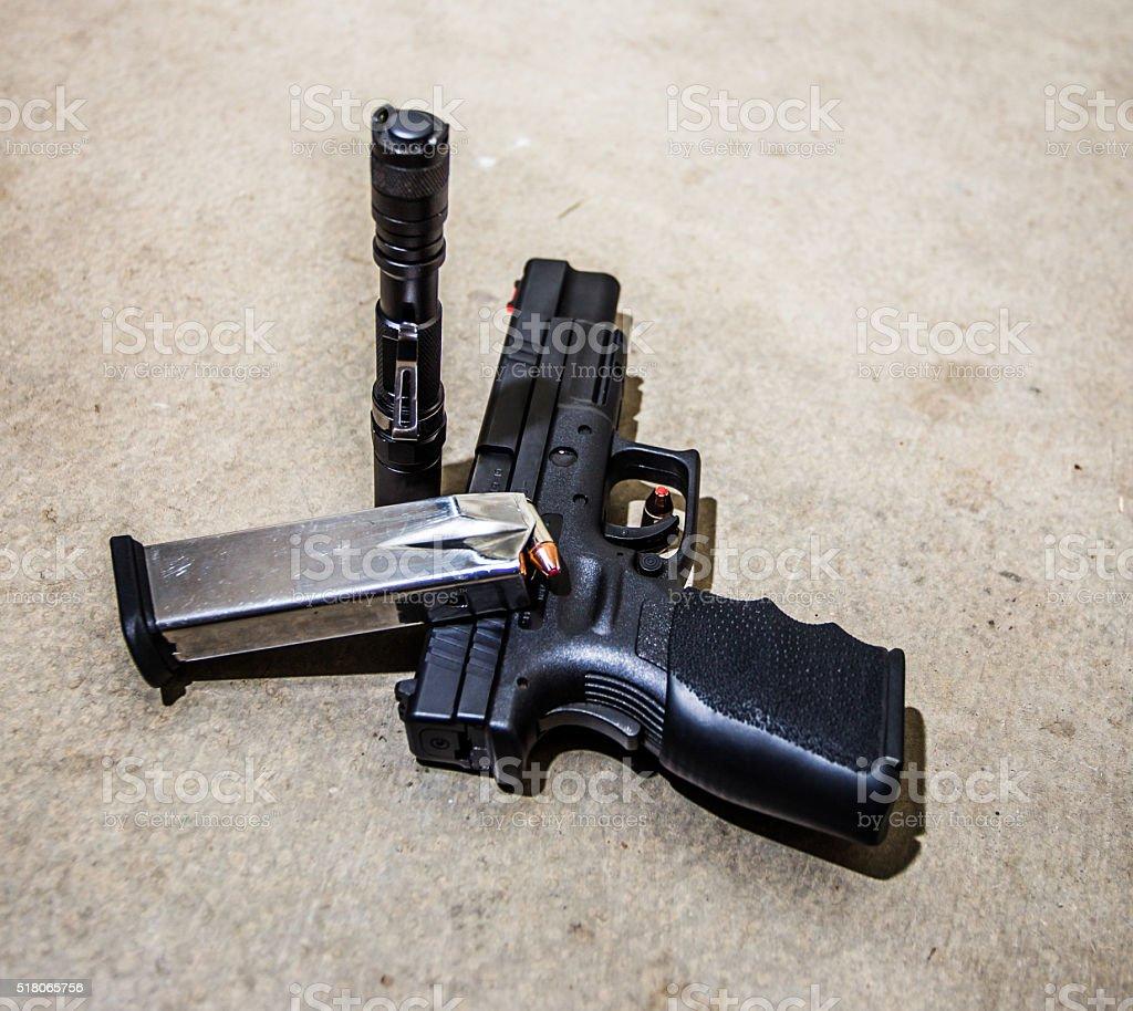 Handgun and Flashlight. stock photo