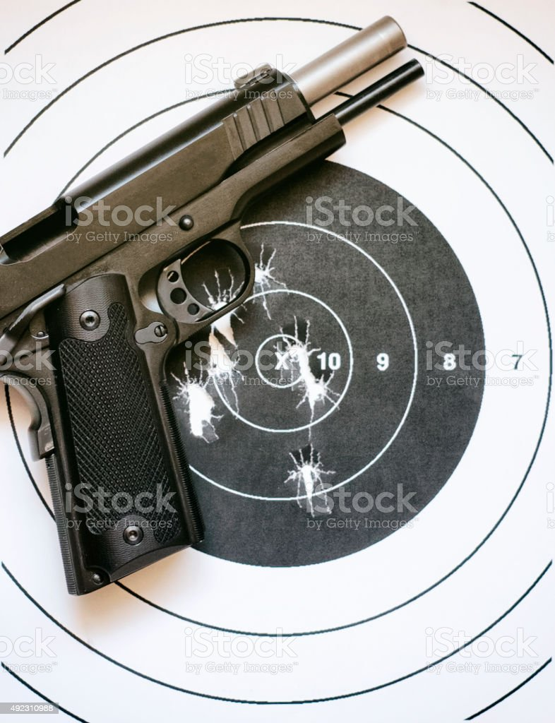 Handgun and Target stock photo