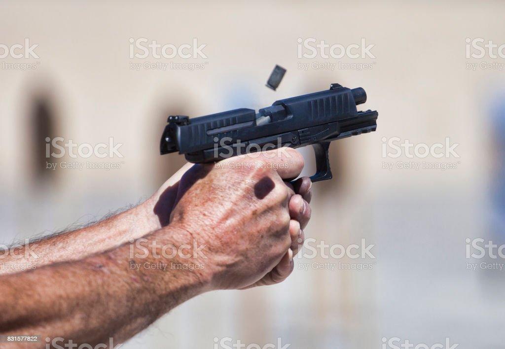 Handgun being shot stock photo