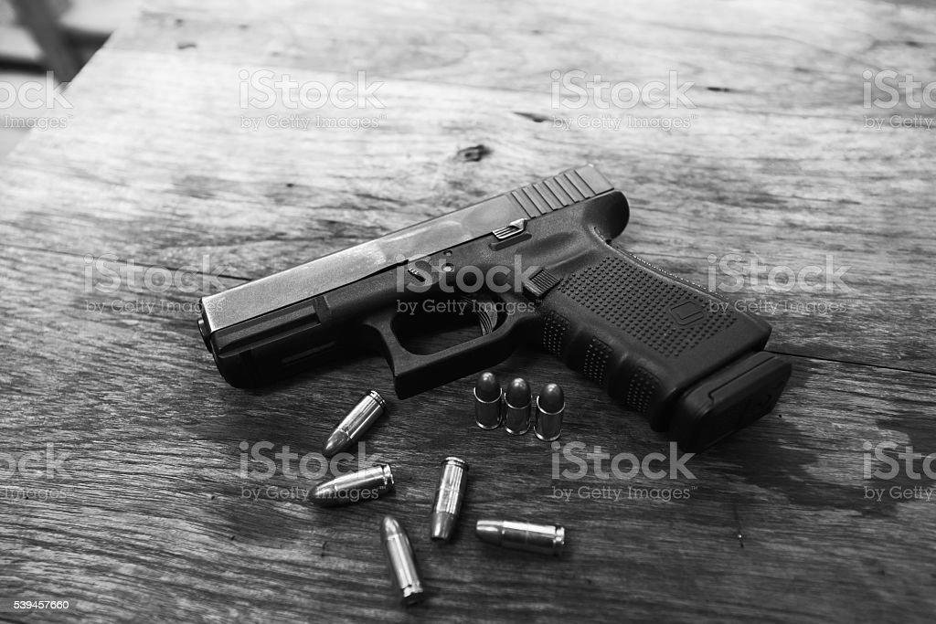 handgun bullets on wood table stock photo