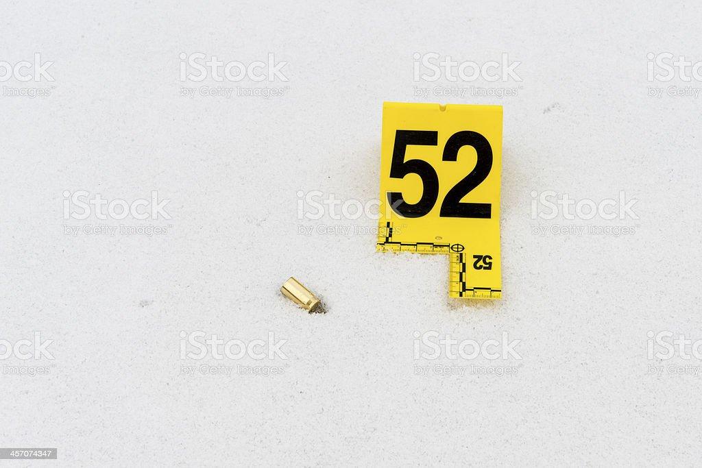 handgun evidence in snow stock photo