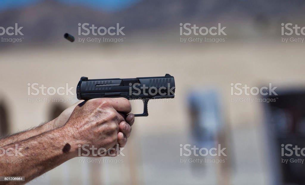 Handgun in action stock photo