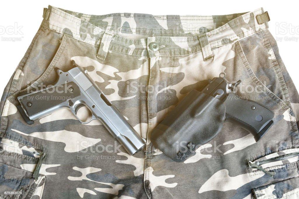 handgun on camouflage pant stock photo