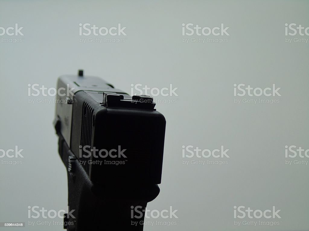 Handgun sights and barrel first person perspective stock photo