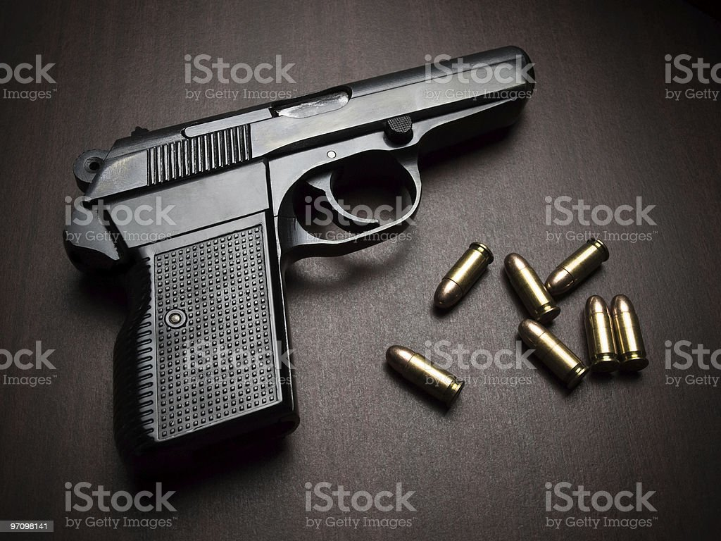 handgun with bullets stock photo