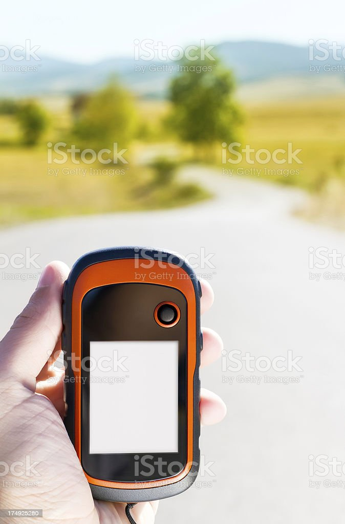 Handheld GPS in nature with a blank screen - vertical stock photo