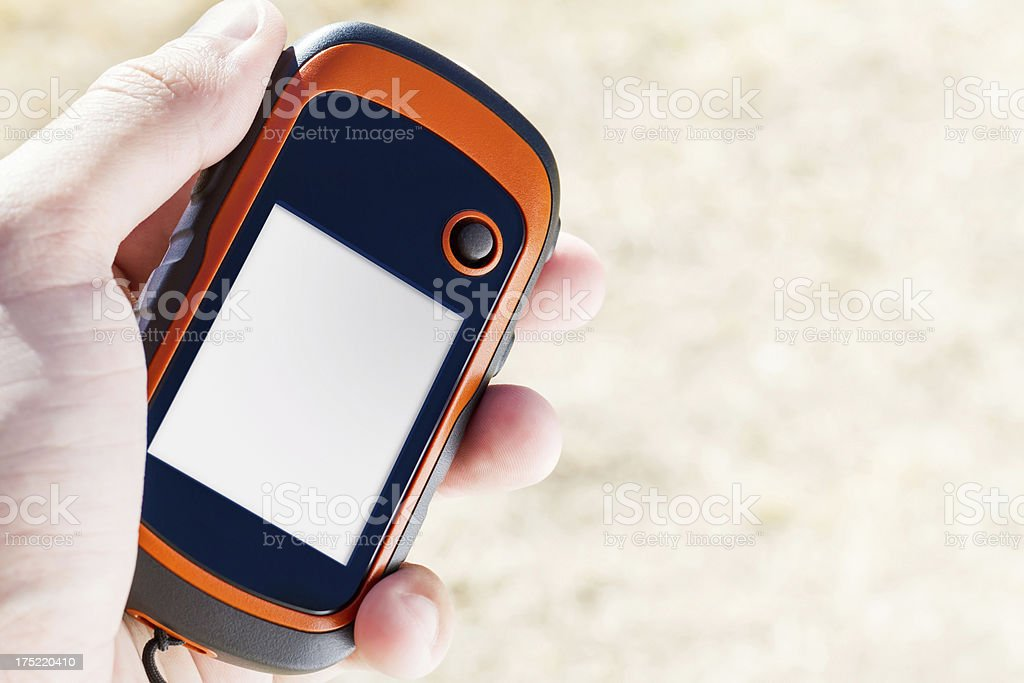 Handheld GPS unit with a blank screen stock photo
