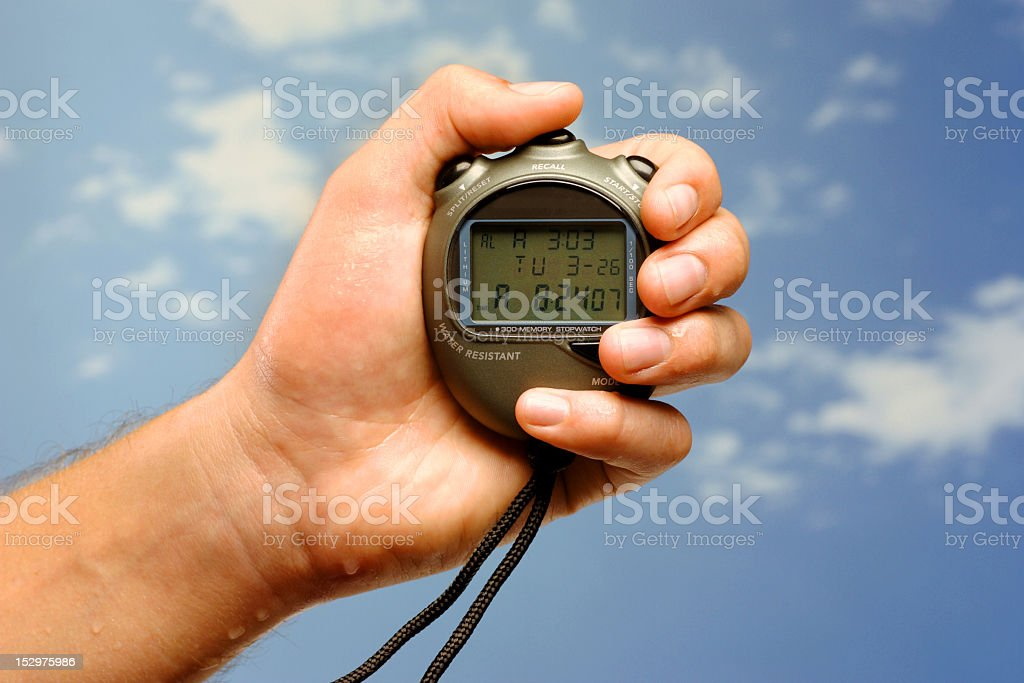 Handheld stop watch stock photo