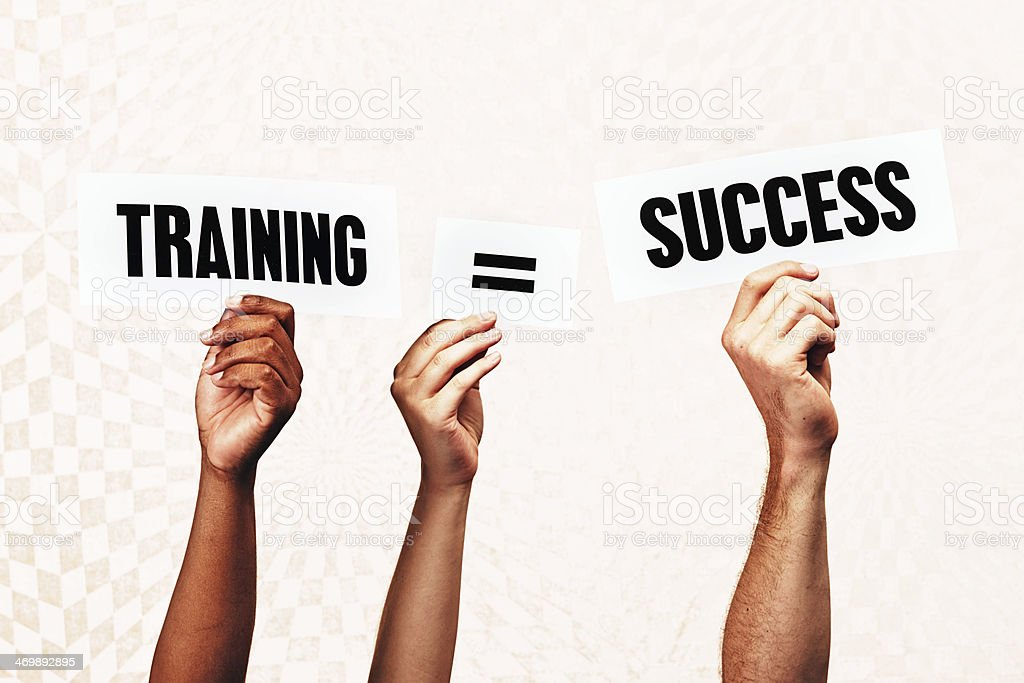 Hand-held words say 'Training = success'. Very true! royalty-free stock photo