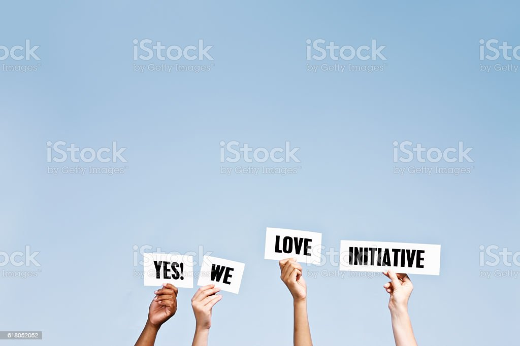 Hand-held words say ' Yes! We love initiative' stock photo