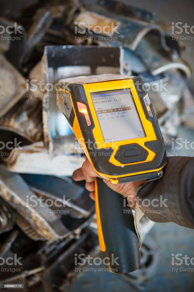 handheld XRF analyzer spectrometer for scrap metal stock photo