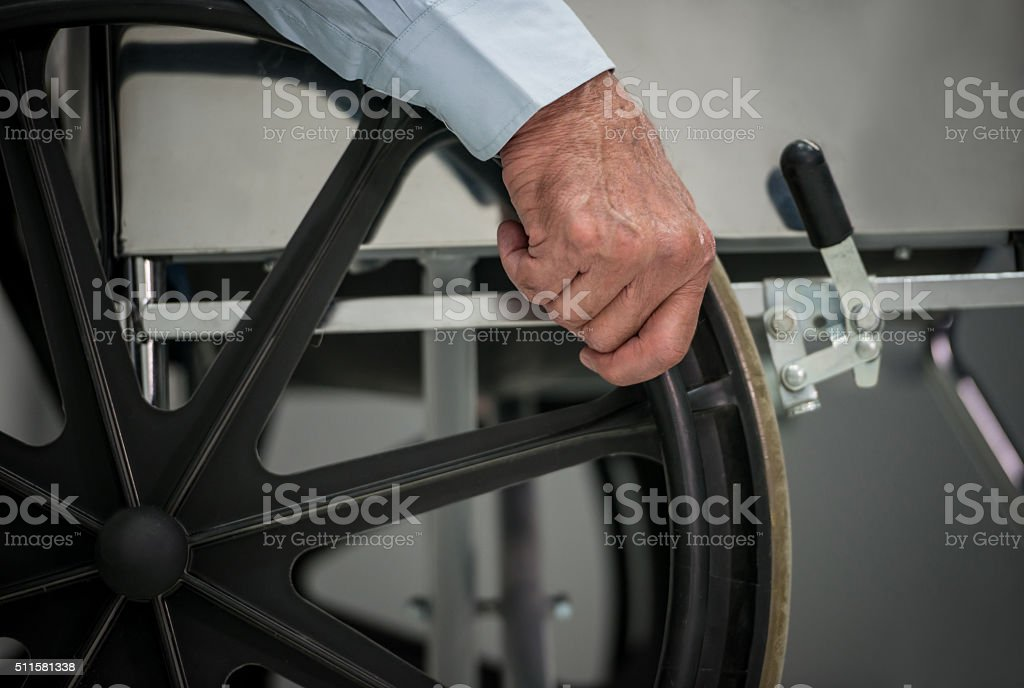 Handicap man at the hospital in a wheelchair stock photo