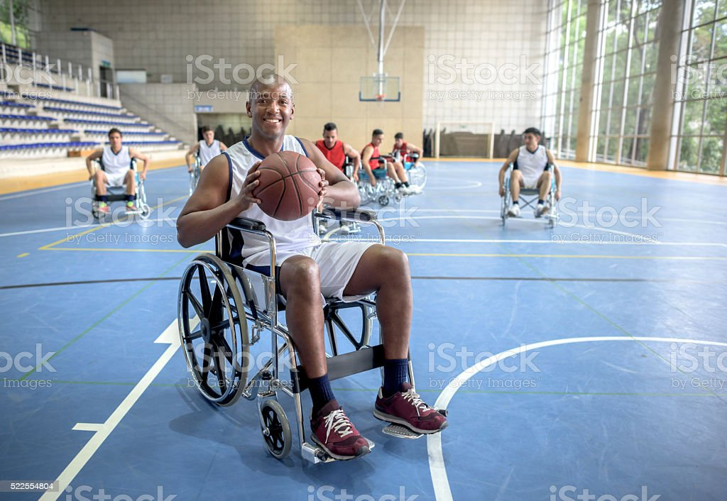 Handicap man playing basket stock photo