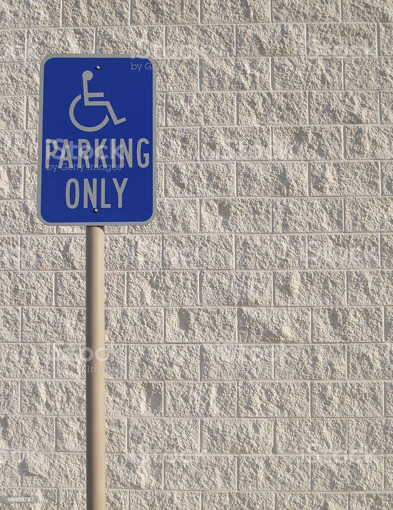 Handicap Parking Sign with White Textured Background Copy Space royalty-free stock photo
