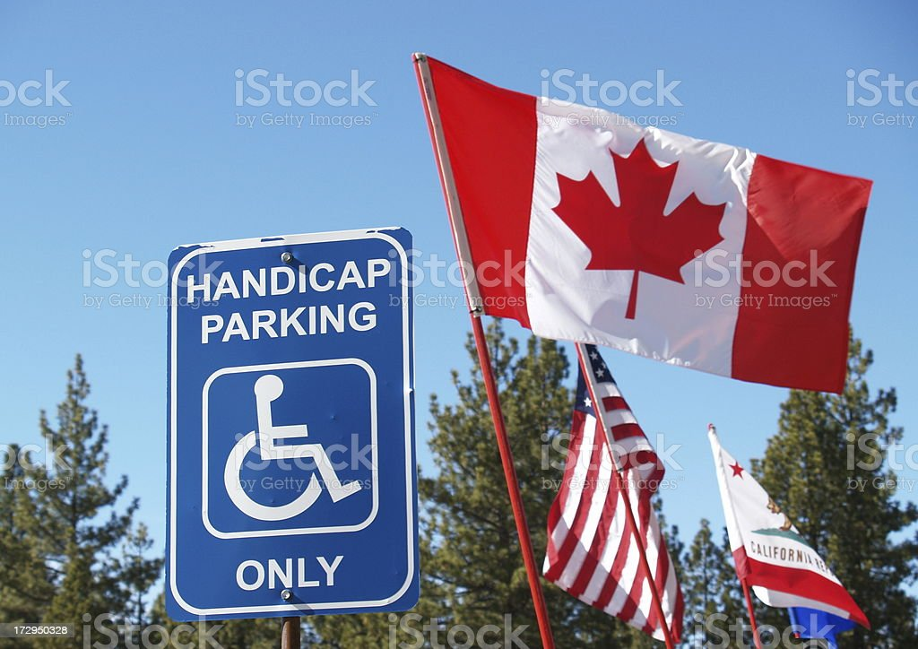 Handicap Parking with Flags stock photo