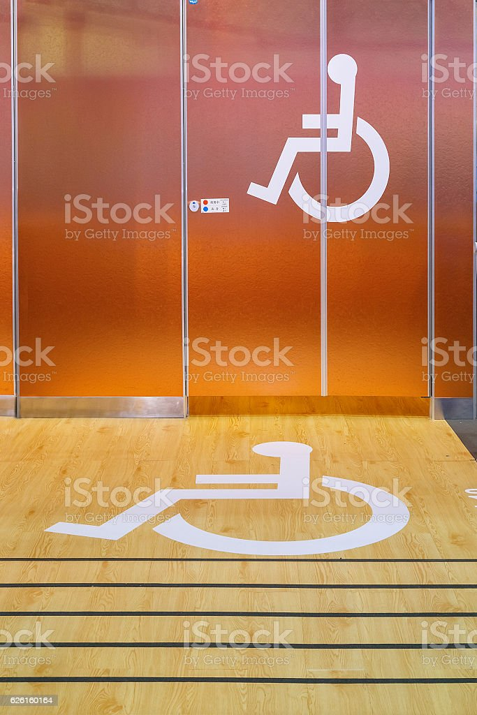 Handicap Sign in front of a Public Toilet stock photo