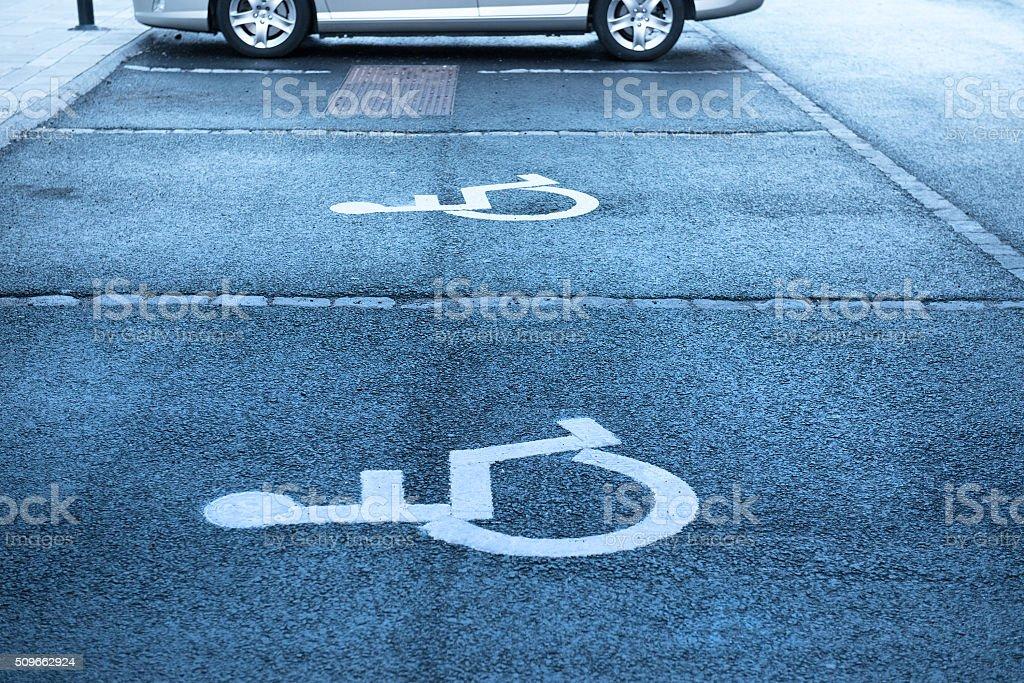 Handicap symbol on parking space stock photo