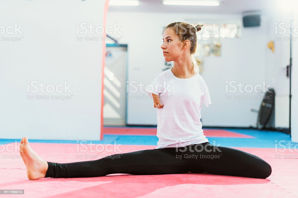 Handicapped athlete stretching for training stock photo