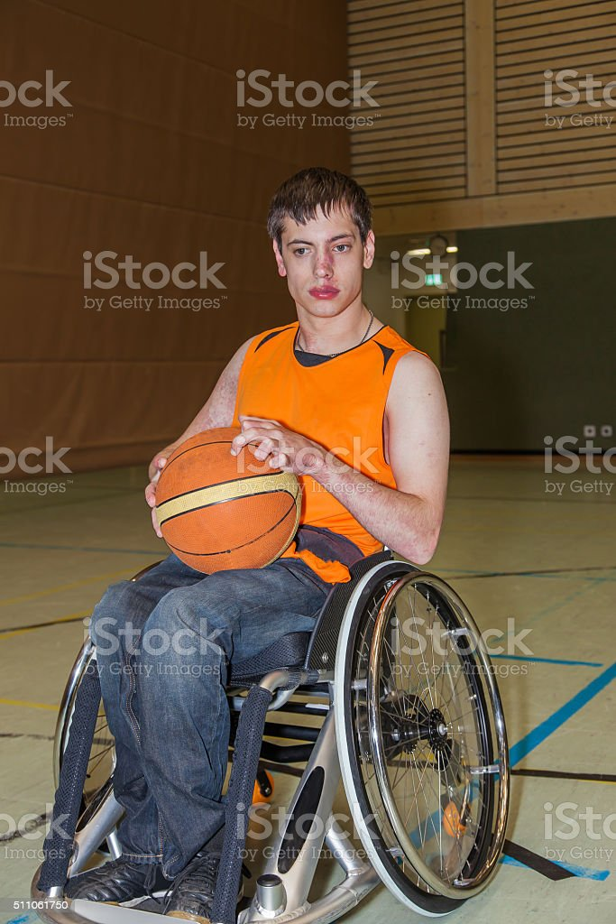 Handicapped boy in basketball training.