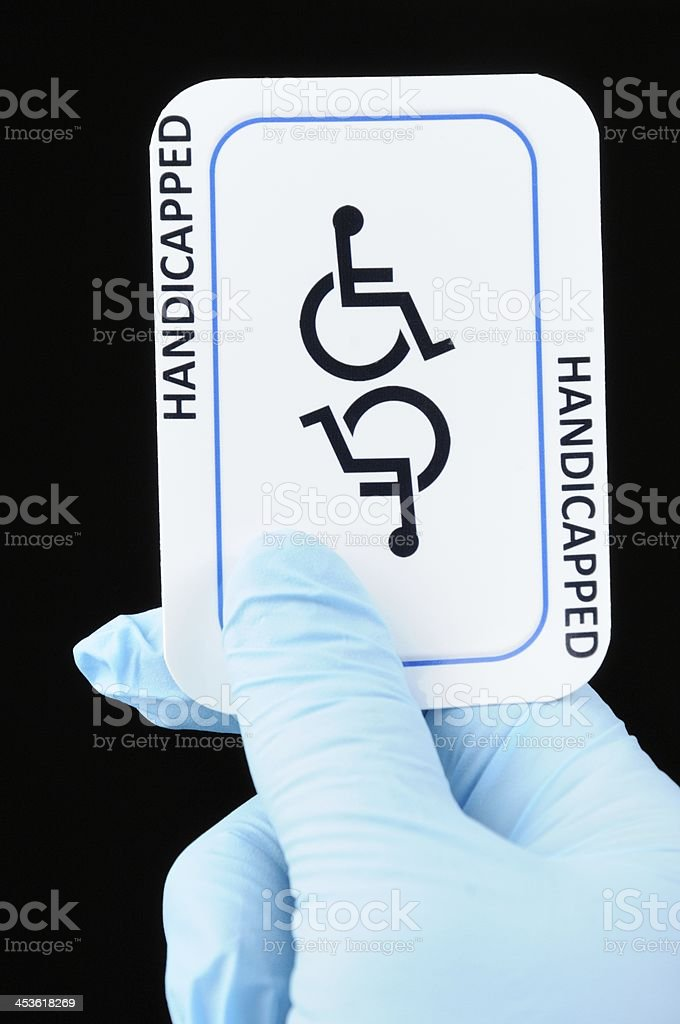Handicapped card with latex gloves royalty-free stock photo