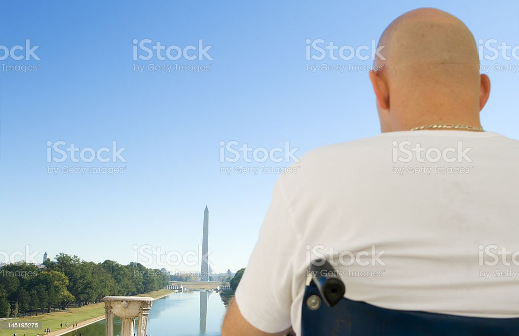 Handicapped Caucasian Man in Wheelchair Looking at Washington Monument, DC royalty-free stock photo