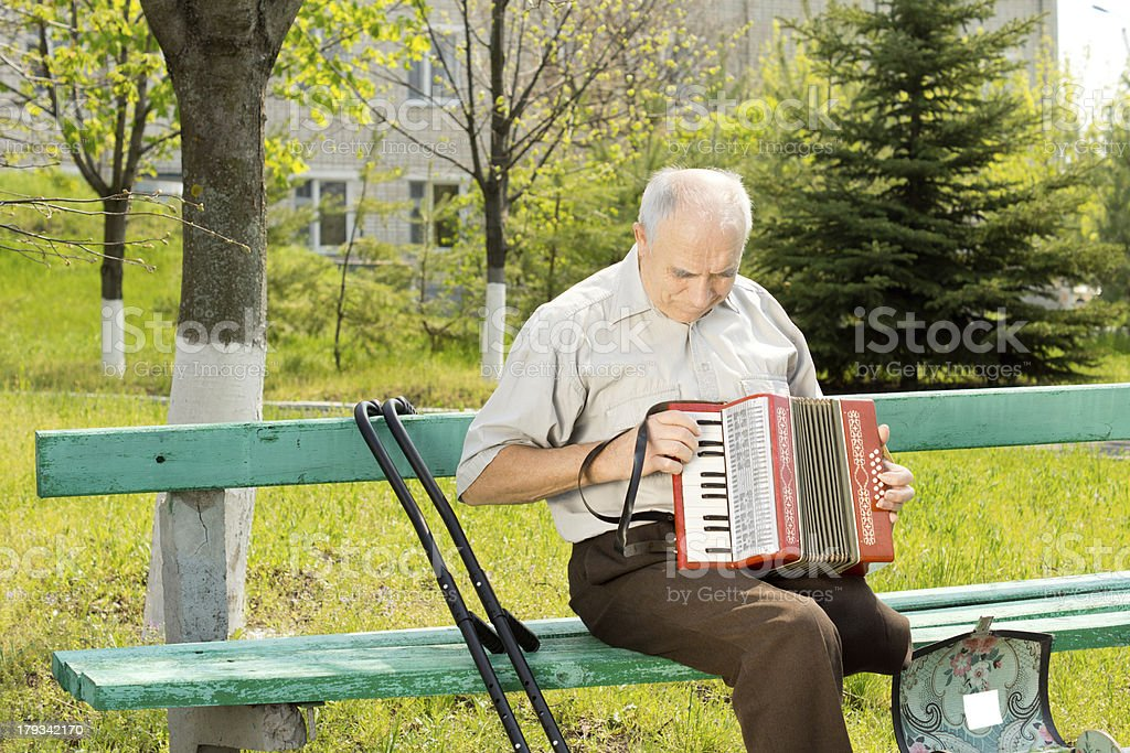Handicapped man playing the accordion royalty-free stock photo
