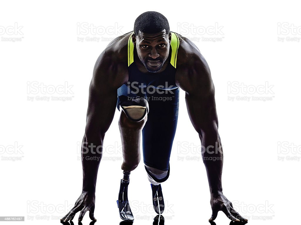 handicapped man runners sprinters with legs prosthesis silhouette stock photo