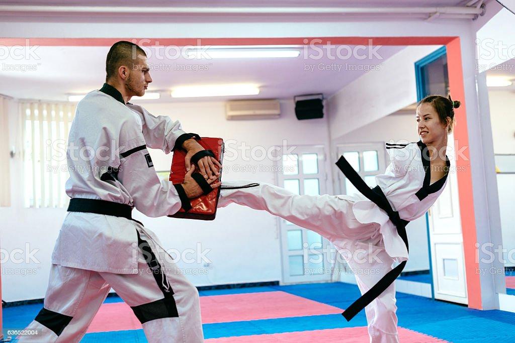 Handicapped martial arts trainee practicing taekwondo stock photo