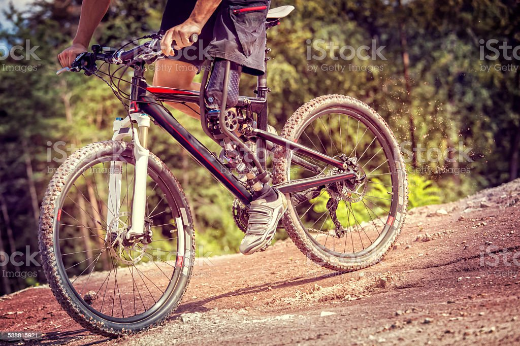 Handicapped mountain bike rider downhill track stock photo