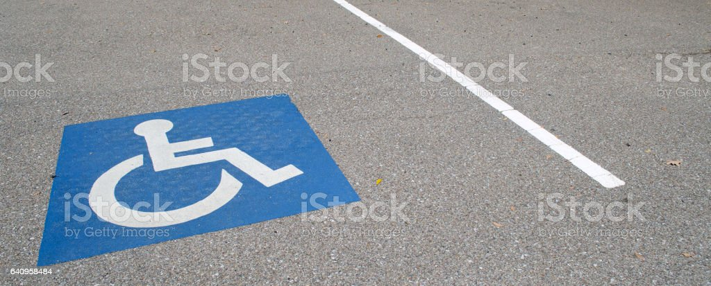 Handicapped Parking Logo In A Parking Space stock photo